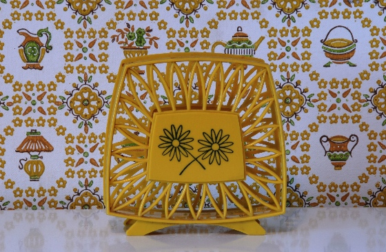 yellow plastic vintage napkin holder